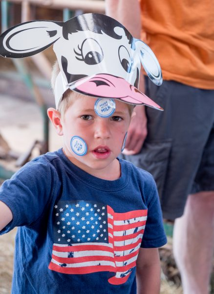 Boy with cow hat and stickers