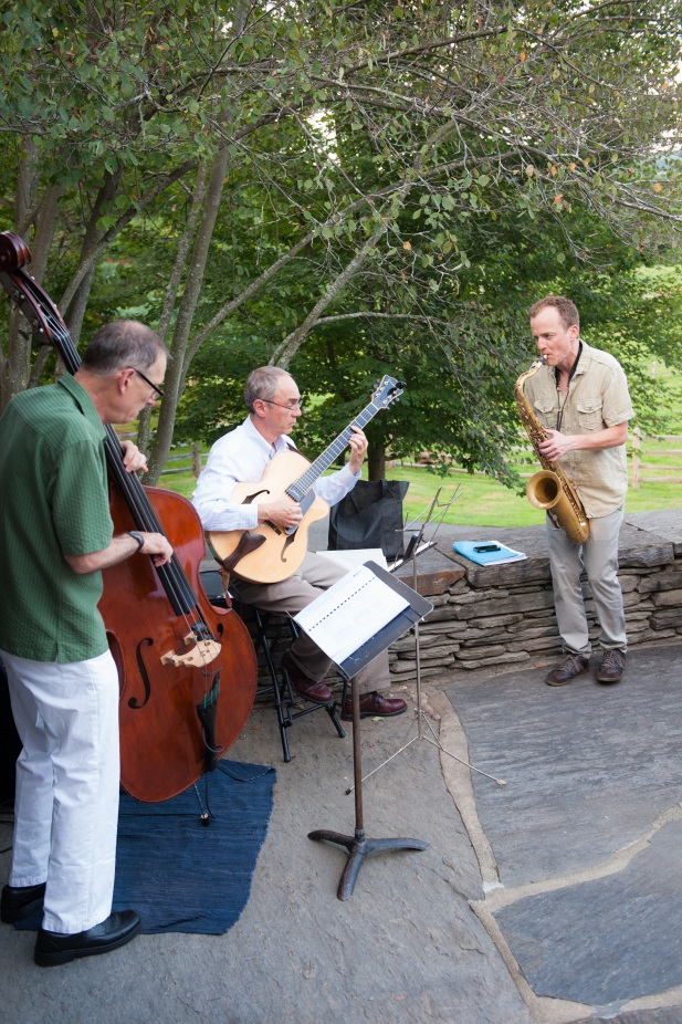 The David Westphalen Trio played the cello, guitar and saxophone on the Billings Farm terrace as guests arrived.