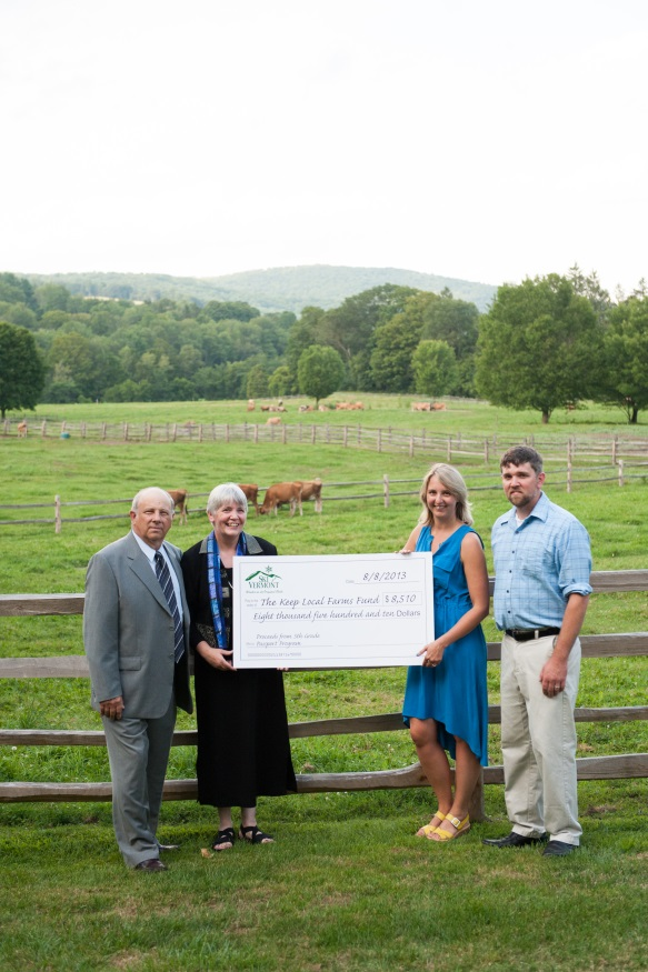 Dairy farmers accept a check for $8,510 from Sarah Neith of Ski Vermont to benefit the Keep Local Farms Fund, which supports the long-term viability of New England's dairy farms. (From left to right: Tim Bryant, dairy farmer from Pawlet, VT and Chairman of New England Dairy Promotion Board; Beth Kennett, dairy farmer and owner of Liberty Hill Farm Inn, Rochester, VT; Sarah Neith of Ski Vermont; David Kennett of Liberty Hill Farm Inn, Rochester, VT.)
