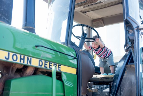 Tractor kid playing