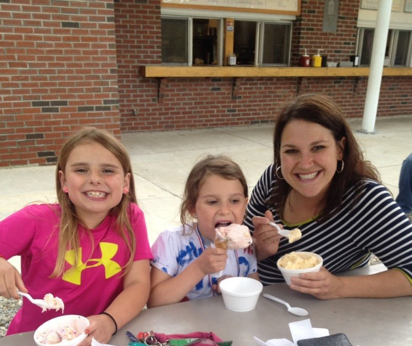 mom and daughters eating ice crea