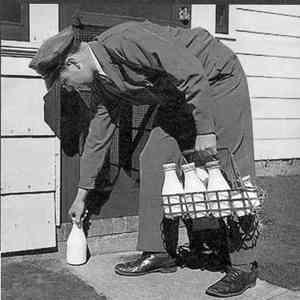 The milkman dropping off milk