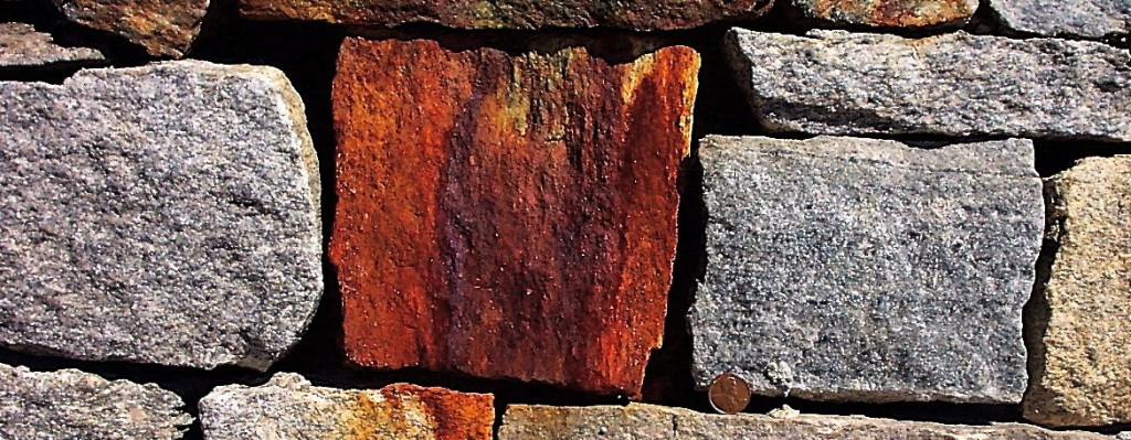 rust stained rocks in wall