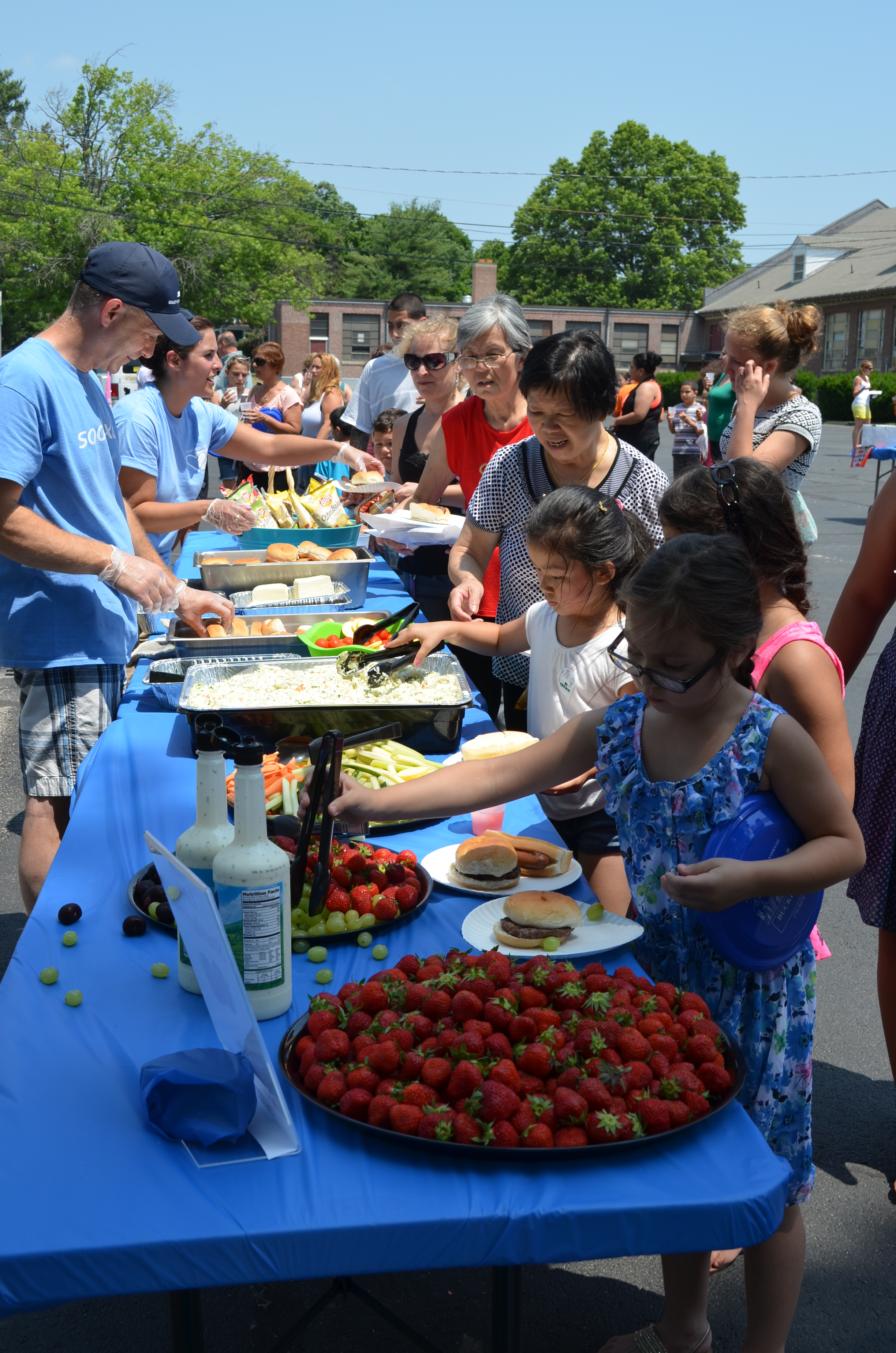 Kids and families getting a summer meal